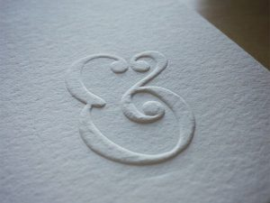 ampersand-embossed
